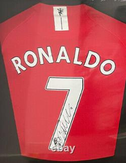 Double Framed Manchester United Shirts Signed By Ronaldo and Fernandes + COA