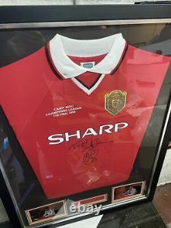 Signed manchester united shirt framed Sheringham And Solsklaer